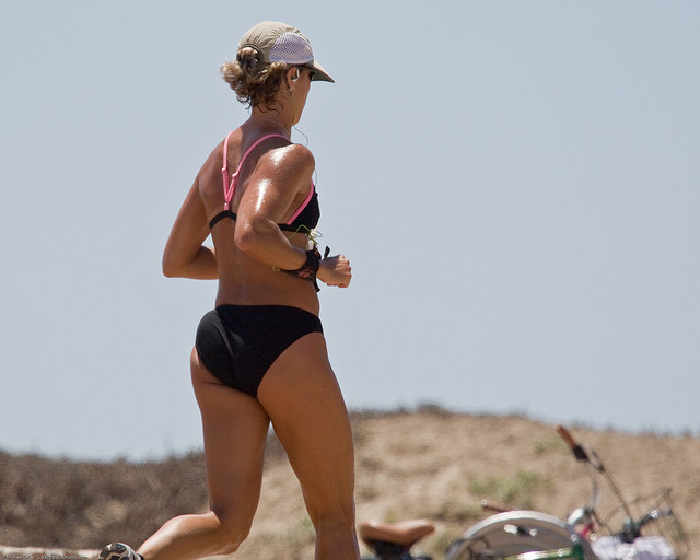 Female jogger with good tan jogging - Scenes from Morro Bay, CA