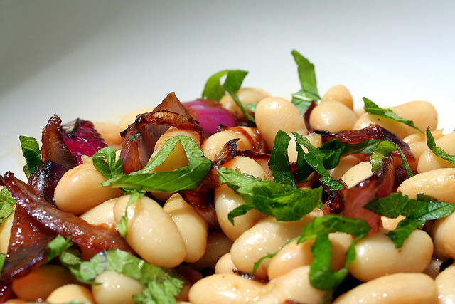 Fresh beans with caramelized red onions and mint