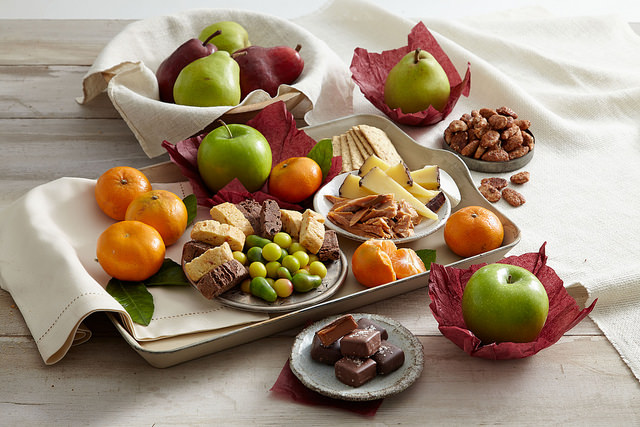 Granny Smith apples pears oranges cheese salted chocolate covered caramels fudge meat walnuts